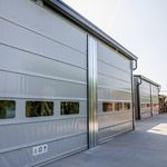 puerta enrollable / de PVC / de tejido