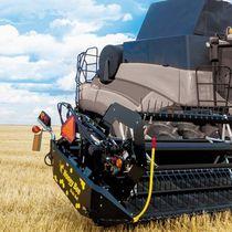 Grain harvesting header / rigid / draper / with gauge wheels