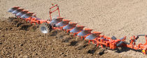 Semi-mounted plow / reversible