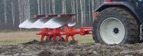 Mounted plow / reversible / with gauge wheel