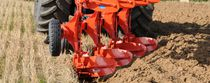 Mounted plow / reversible / with hydraulic adjustment