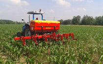 Trailed row crop cultivator / folding