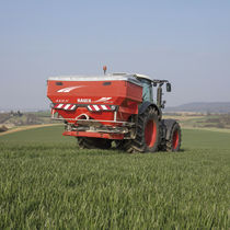 Tractor-mounted fertilizer spreader