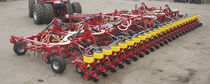 Mounted field cultivator / with roller / 3-point hitch / spring tine