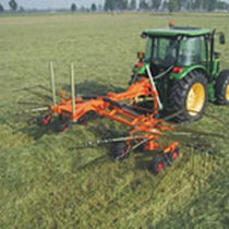 Rotary swather rake / center delivery