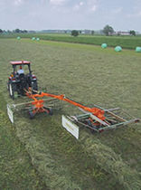 Rotary swather rake / side delivery