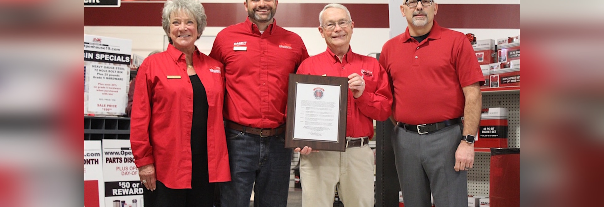 "Patti Young (left), Tom and Bill Stannard (center) received an honor from Wellington Mayor Hans Schneider, proclaiming ""Wellington Implement Day"" in honor of the company's 90th year."