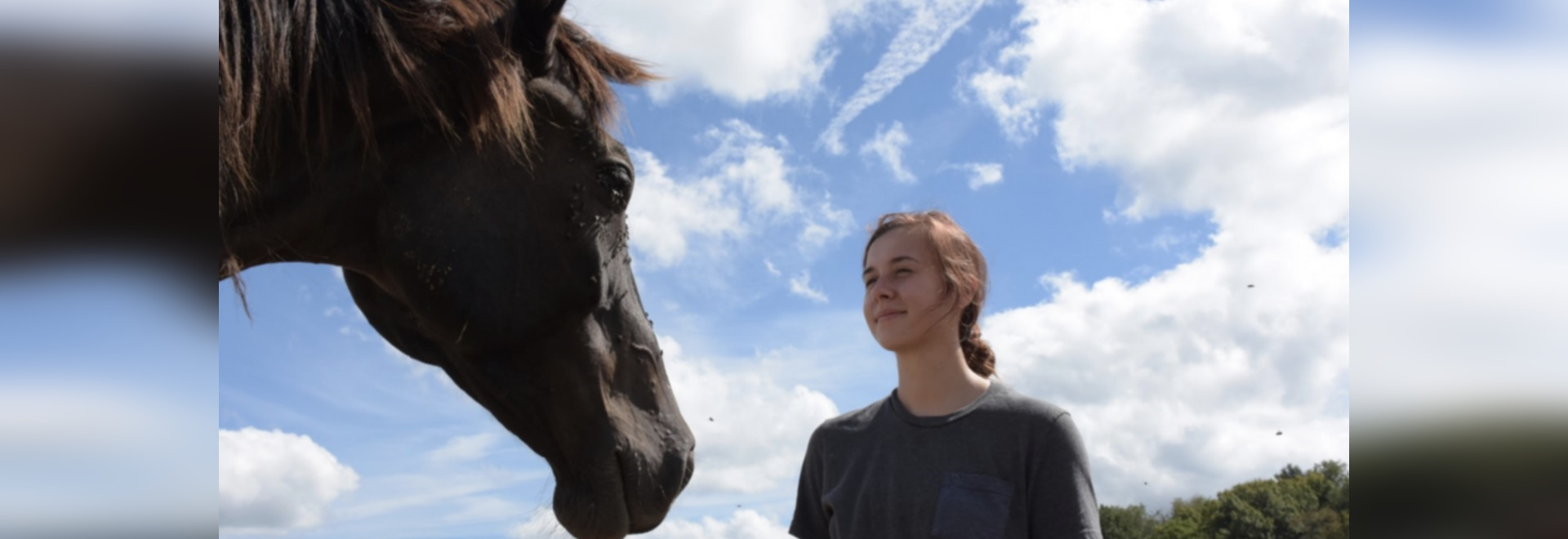Paulina Oleinik, a senior in Penn State's College of Agricultural Sciences, is one of the live-in employees at the Penn State Horse Barn. Photo credit: Penn State.