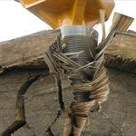 fendeuse de bûches à vis hydraulique / monté sur excavateur