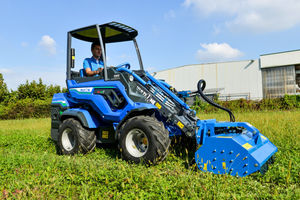 rubber-tired loader / with cab / mini / electric