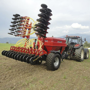 pneumatic seed drill / trailed / double-disc / with disc harrow