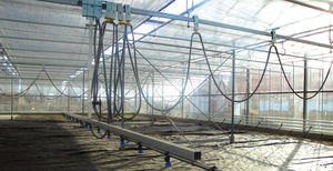 greenhouse irrigation booms / hose-fed / suspended / above ground cable guidance
