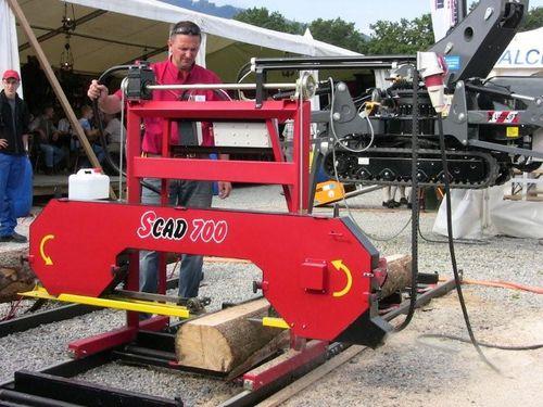 band sawmill / horizontal / with belt conveyor