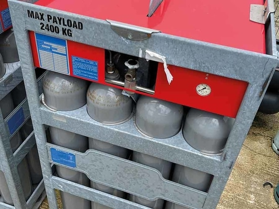 Compressed gas is stored in banks of reinforced cylinders